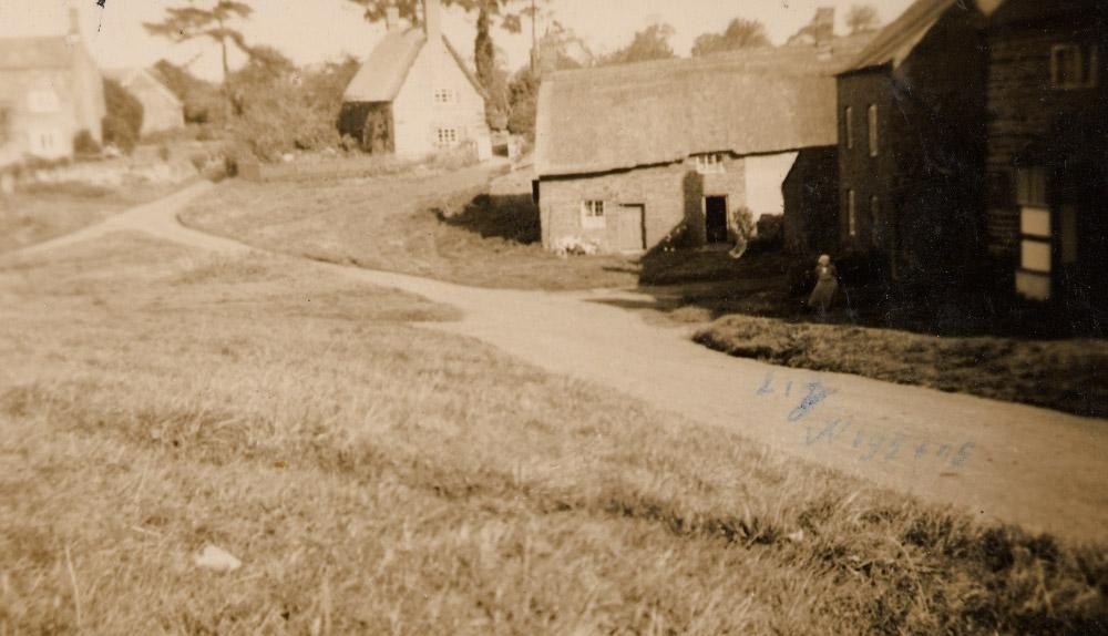 Liz Wiggins outside Tite Cottage