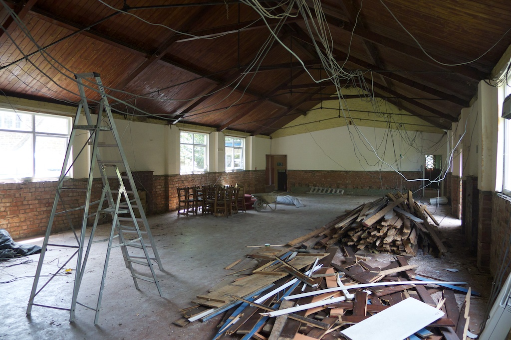 Warding Memorial Hall is stripped out to reveal any problems